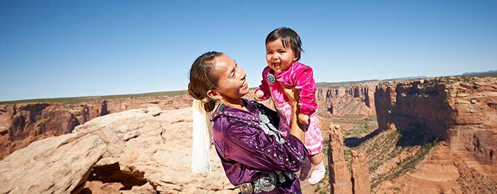 woman and child on with the grand canyon in the background