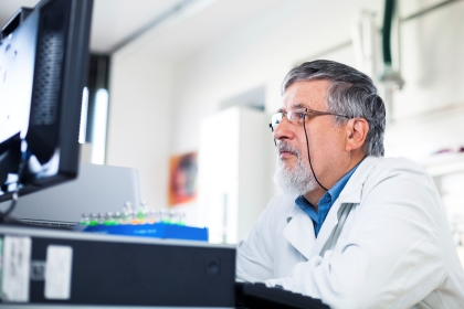 Medical researcher looking at a screen