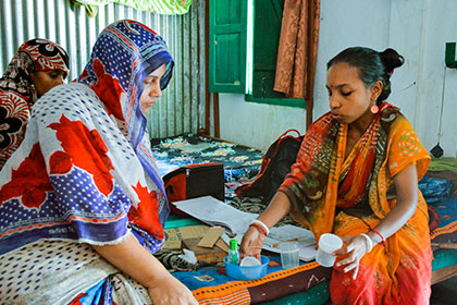 Bangladeshi women working together in a clinic