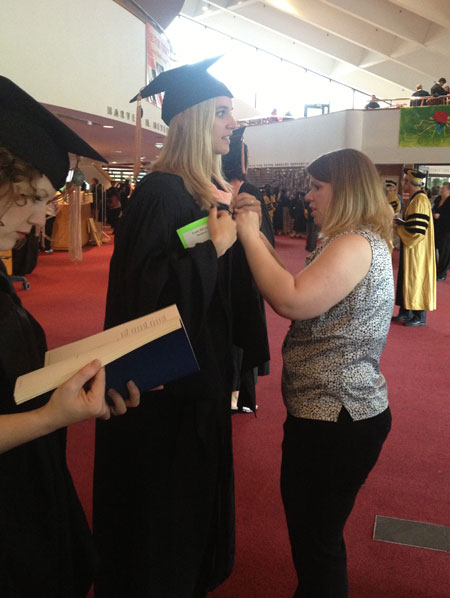 Staff helps arrange robes