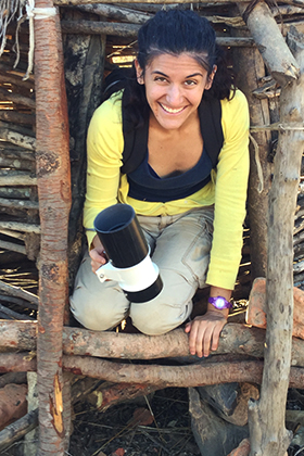 Jordan Hoffman with a mosquito trap in a dwelling in Macha, Zambia