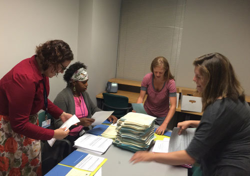 Admissions Staff stuffing Orientation Packets