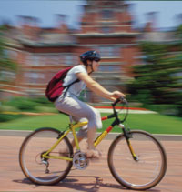 A student bikes past the old Johns Hopkins Hospital