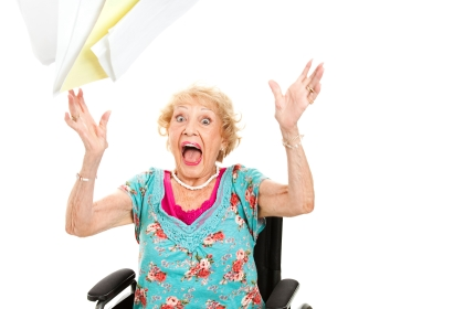 Elderly patient throwing paper upward