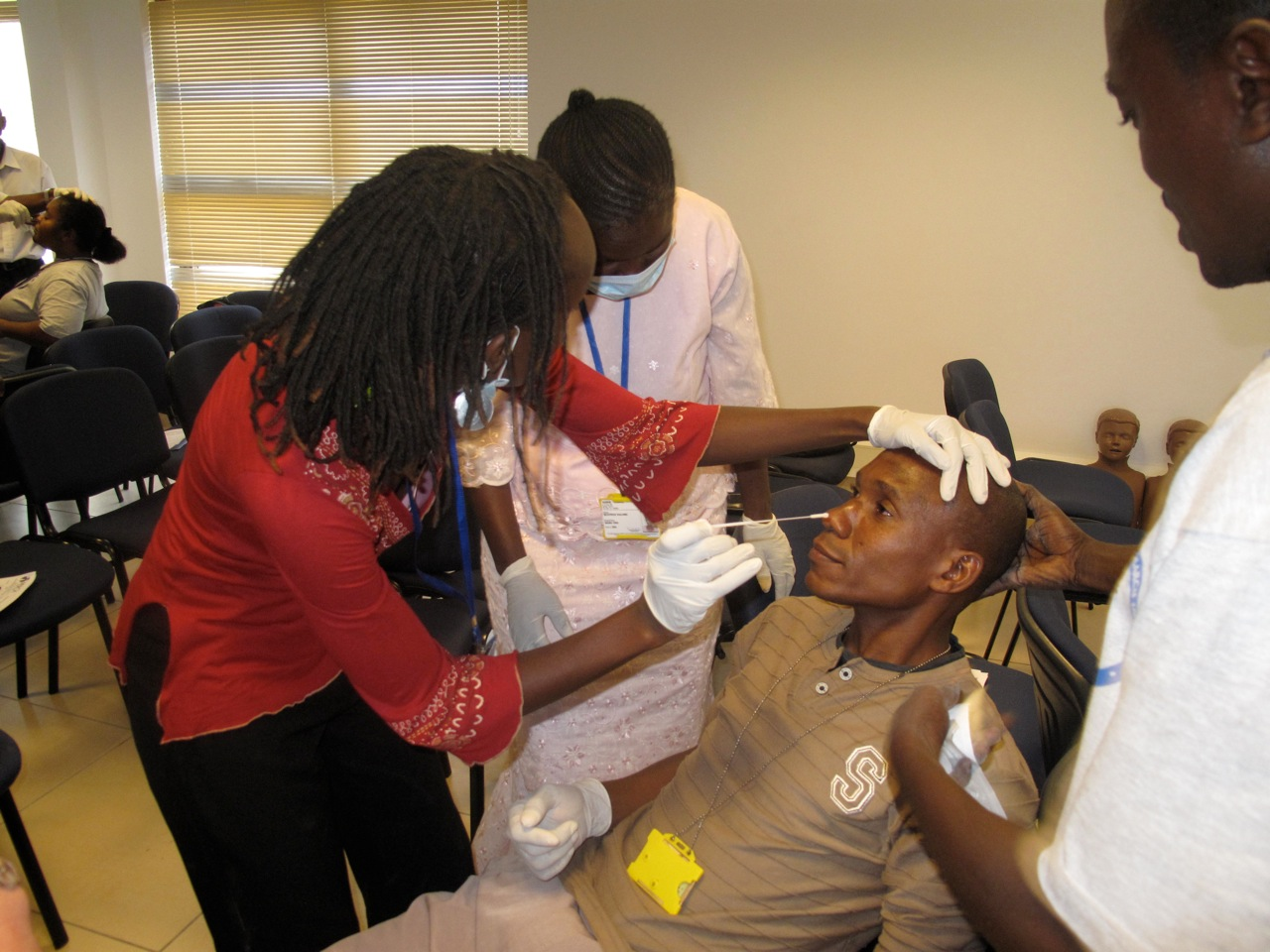 Otieno demonstrates NP swab
