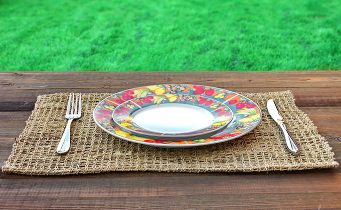 Dinner plate at a wooden table outside