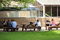 Students, Faculty and Staff eat lunch in the courtyard