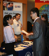 Student talking with employer at Career Fair