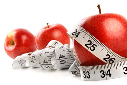 apples with measuring tape