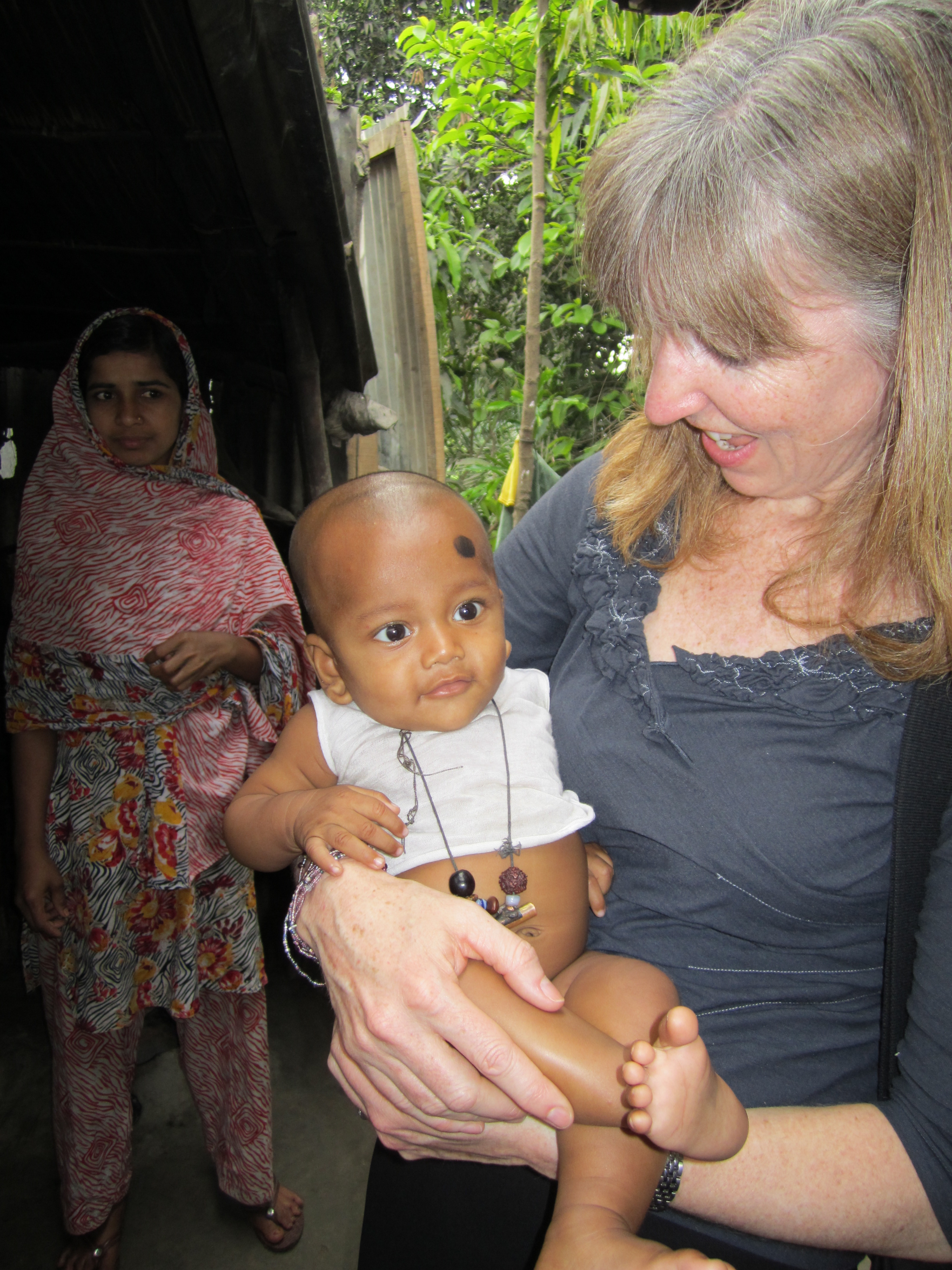 Kate O'Brien with child in Bangladesh