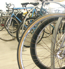 Rows of bicycles occupy parking spaces normally reserved for cars in the School's garage.