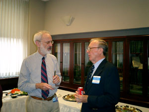 Richey Sharrett (left), adjunct professor of Epidemiology, talks with Thomas M. Daniel.