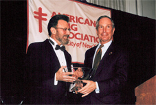 Dr. Peter Smith, (r) chair of American Lung Association of NYC, hands award to Mayor Bloomberg.