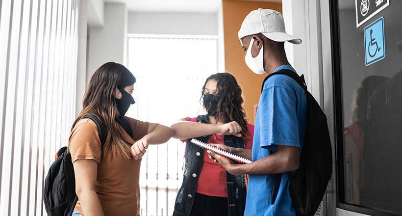 Students in masks in a school hallway