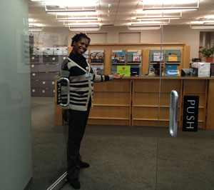 Shenay opens the suite doors for visitors.