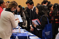 Career Fair Employeer interacts with student