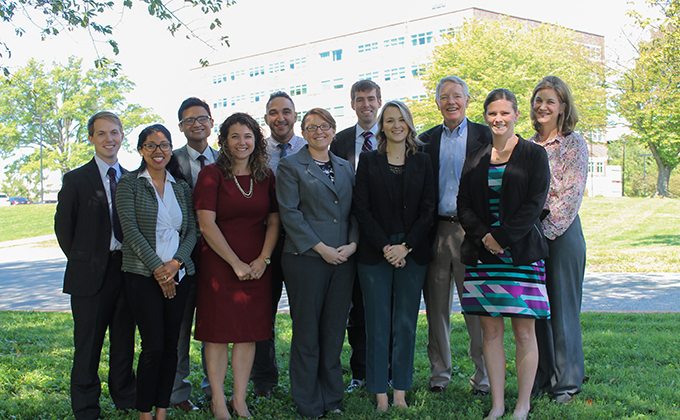 John Ellis (third from right) with a group of current and past residents now working with GBMC (image courtesy GBMC).