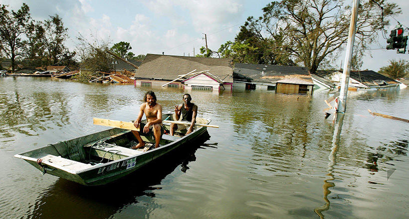 Man in a boat after Hurricane Katrina